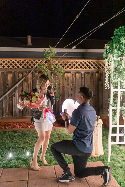 surprise marriage proposal in their own backyard