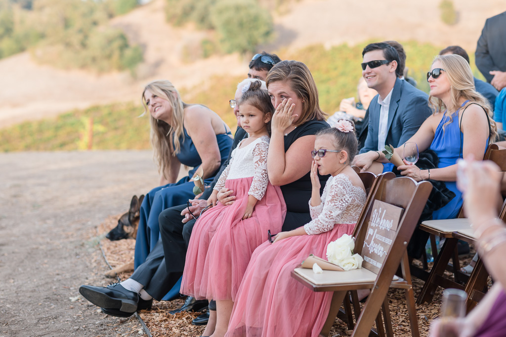 family crying during wedding ceremony