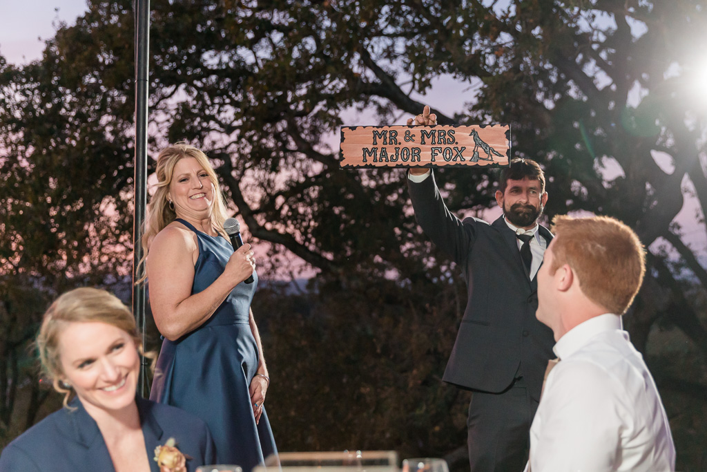 groom's parents surprised them with a handmade wooden sign