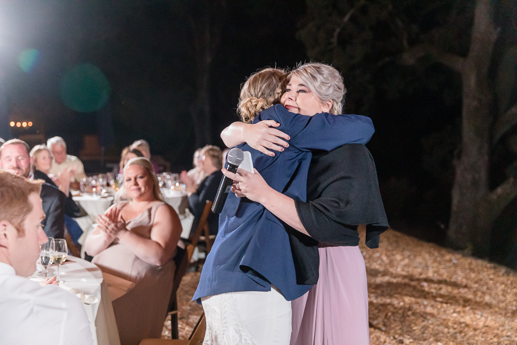 bride hugging with her sister