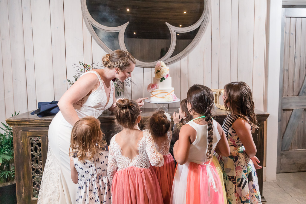 kids surround the cake table
