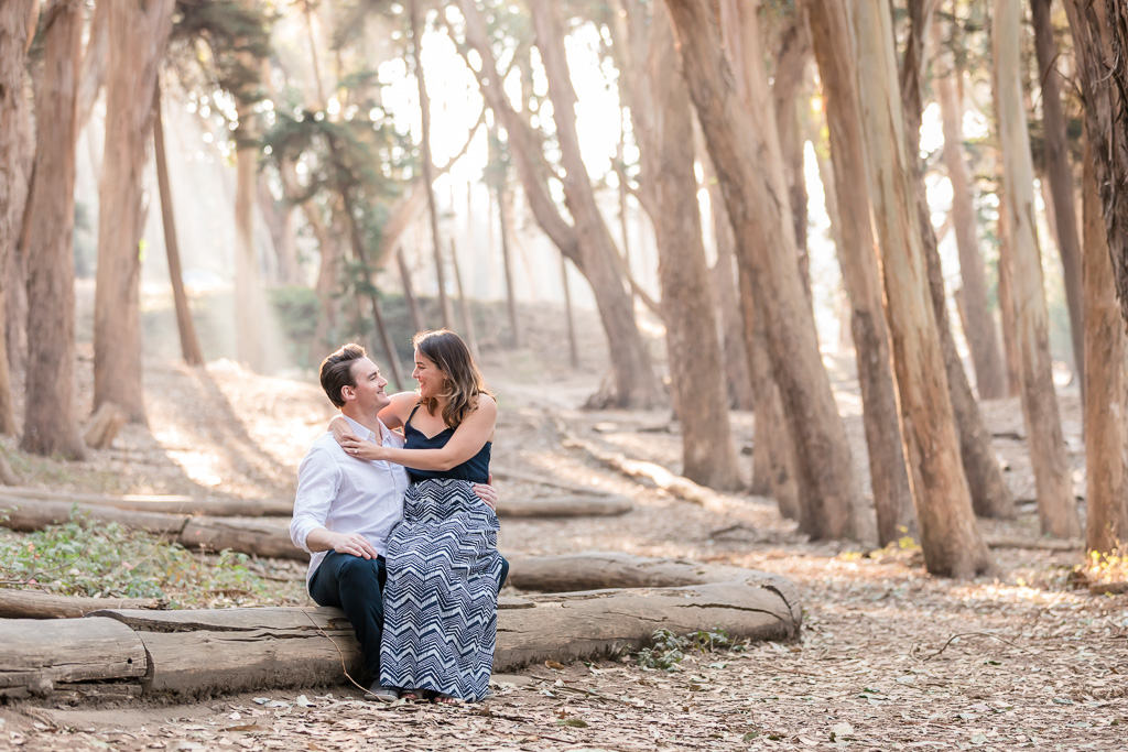 Lovers' Lane San Francisco engagement photo with sunlight pouring through the trees