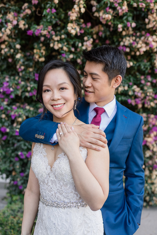 wedding portrait in front of the mansion's purple flower wall