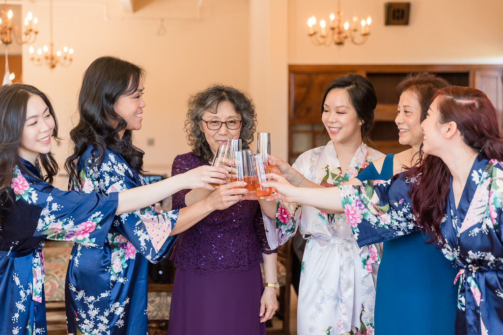 cheers with mothers and bridesmaids