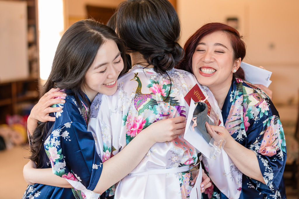 group hug with the bridesmaids