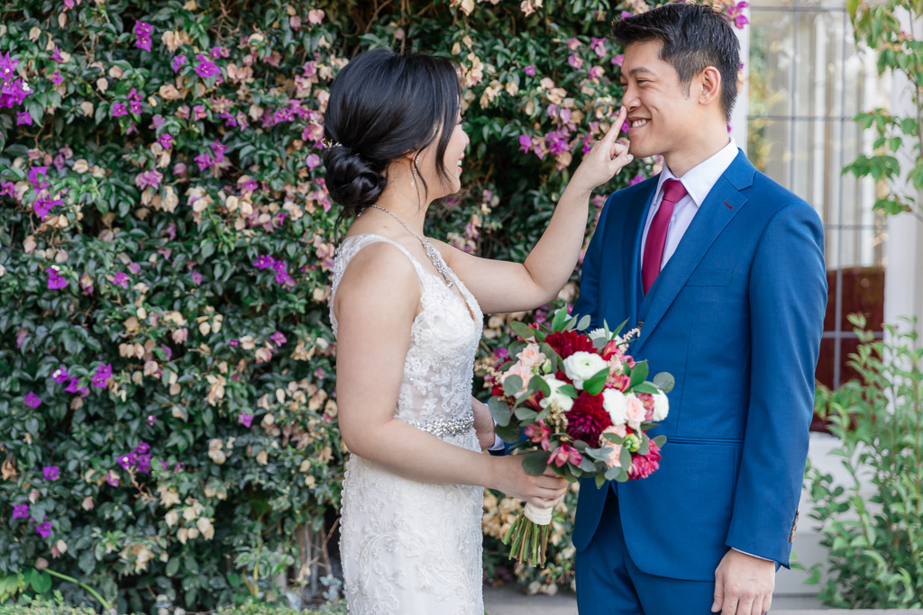 bride poking groom's nose after seeing each other