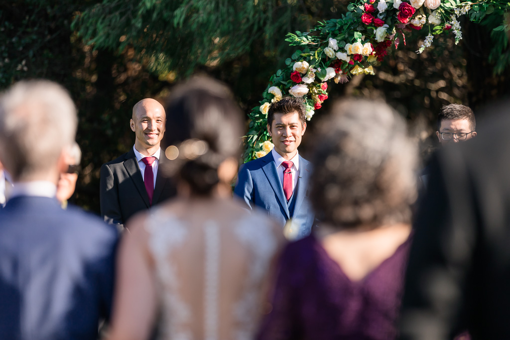 groom's reaction during bride's grand entrance at the ceremony