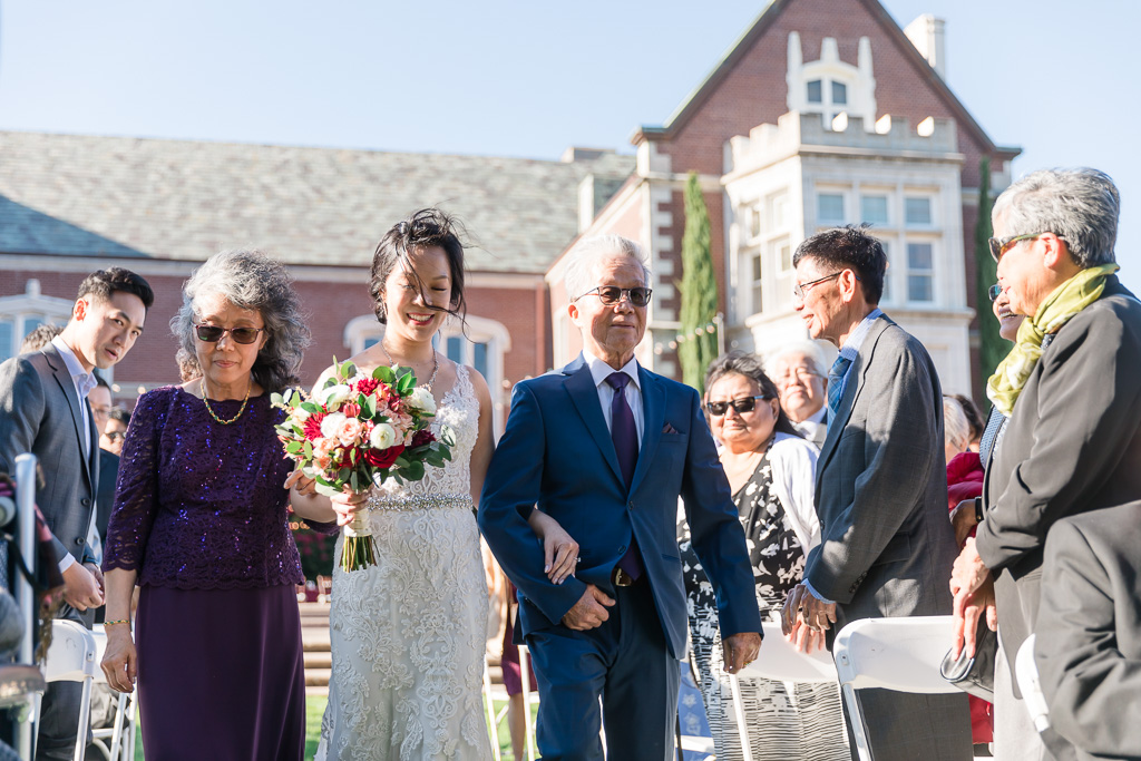 a sunny outdoor ceremony on a windy day