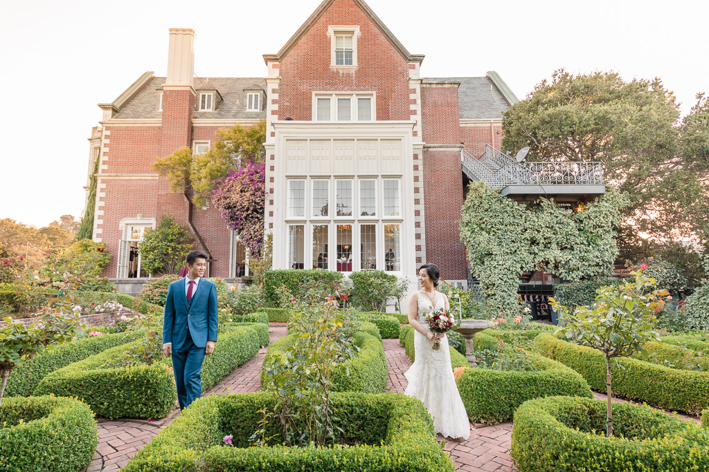Kohl Mansion wedding photo in the lush garden at sunset