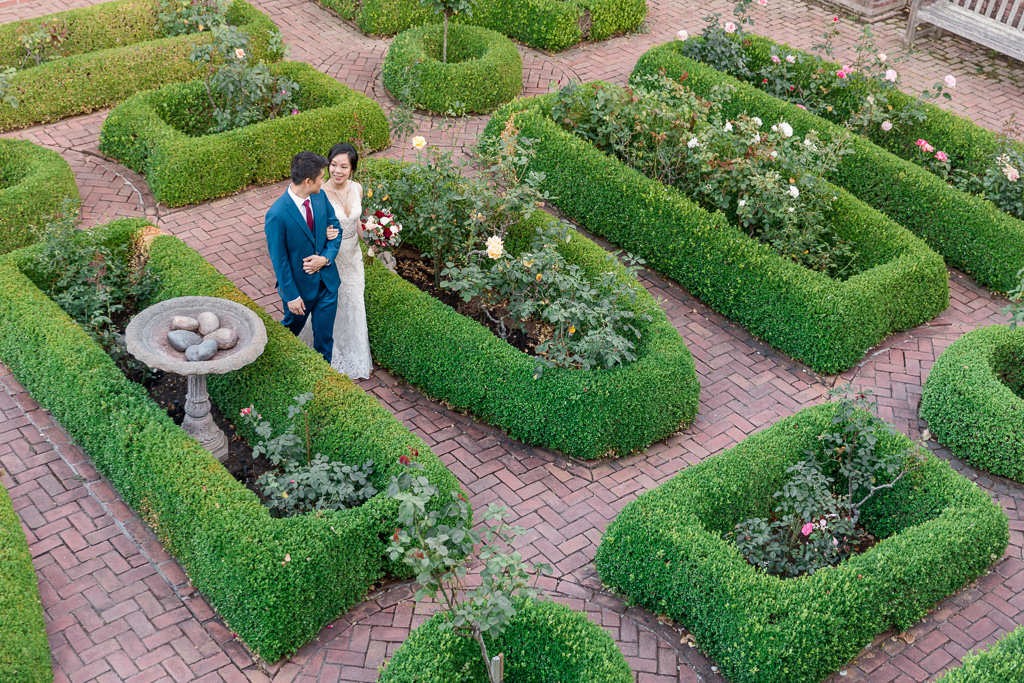 newlyweds walking in the beautifully landscaped garden
