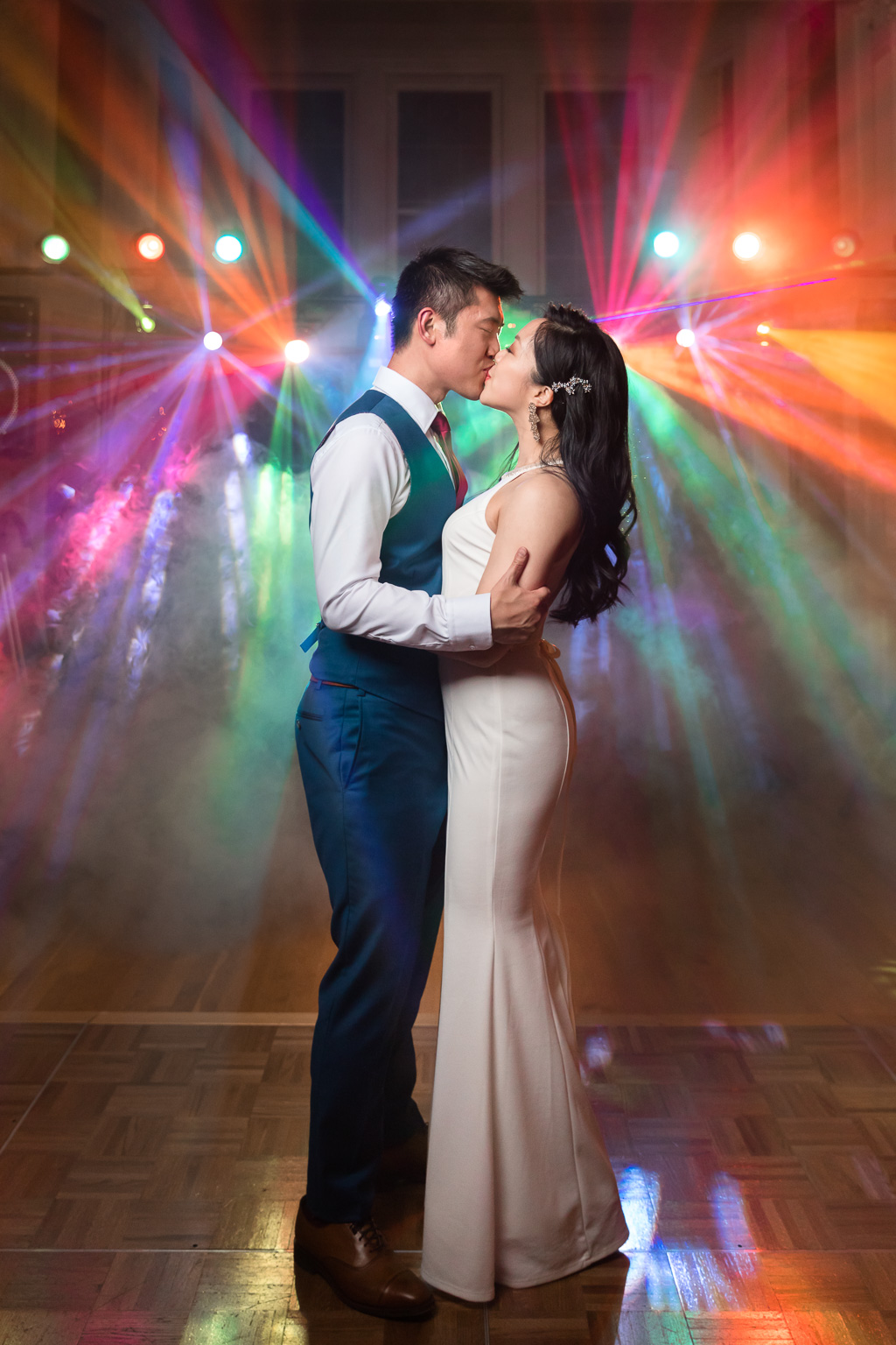 colorful unique DJ lights with fog machine night time wedding portrait