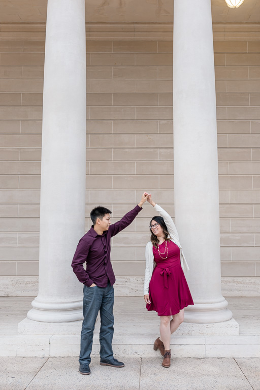 couple dancing in front of the columns
