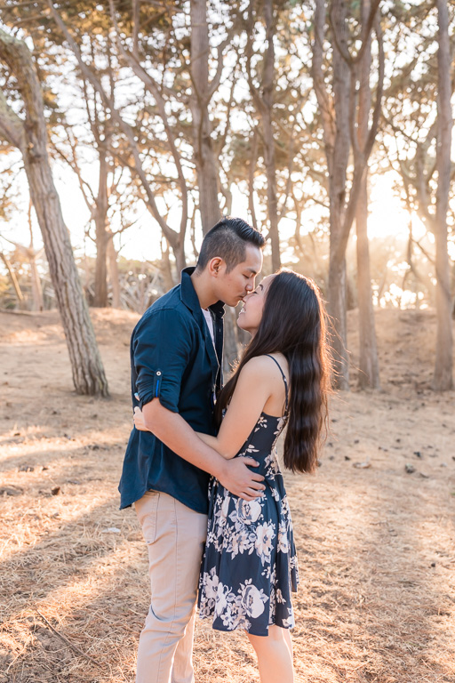 San Francisco engagement portrait with sunlight shining through the trees