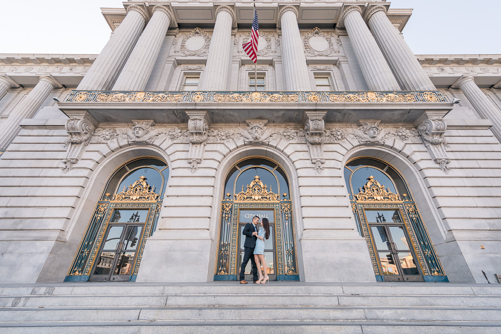 engagement photo outside of San Francisco City Hall