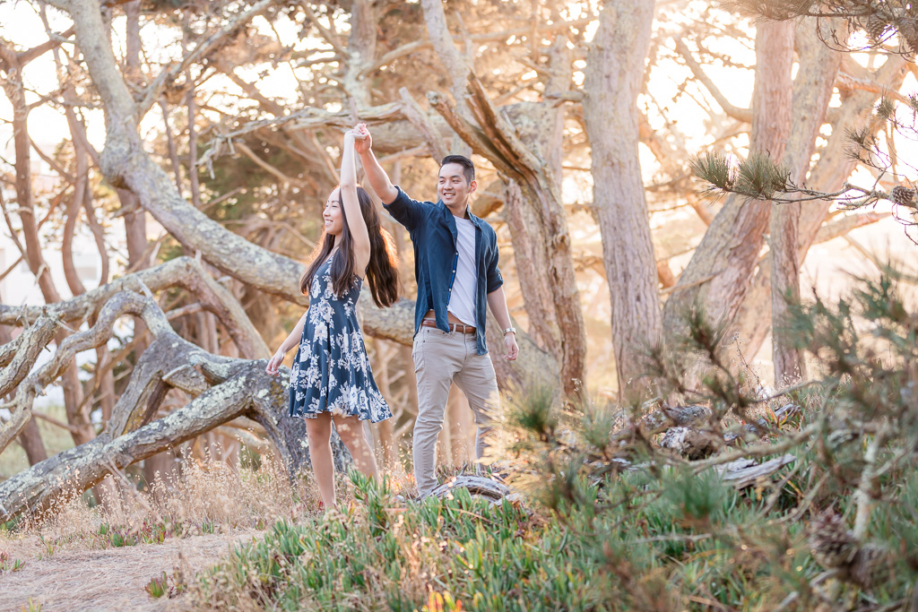 couple dancing in the sunlit forest in San Francisco