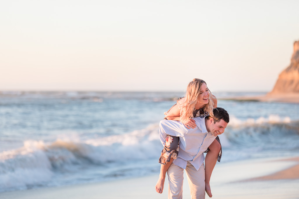 playful and candid Bay Area beach engagement photo