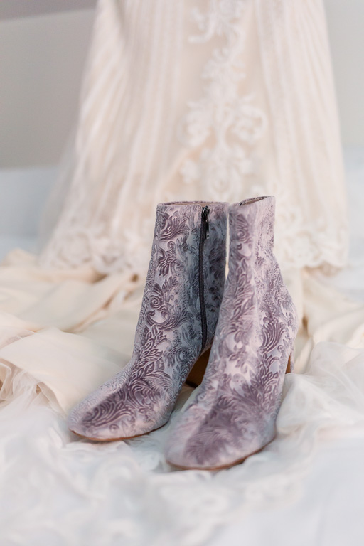 bridal gown and velvet floral boots