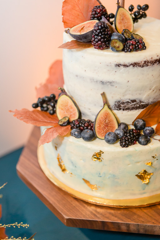wedding at The Pearl SF - stylish wedding cake with fruit, foliage and fall leaves
