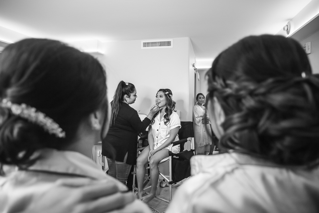bride having her makeup done at Hotel Via