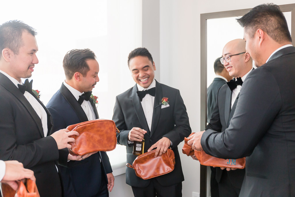 handing out groomsmen's gifts