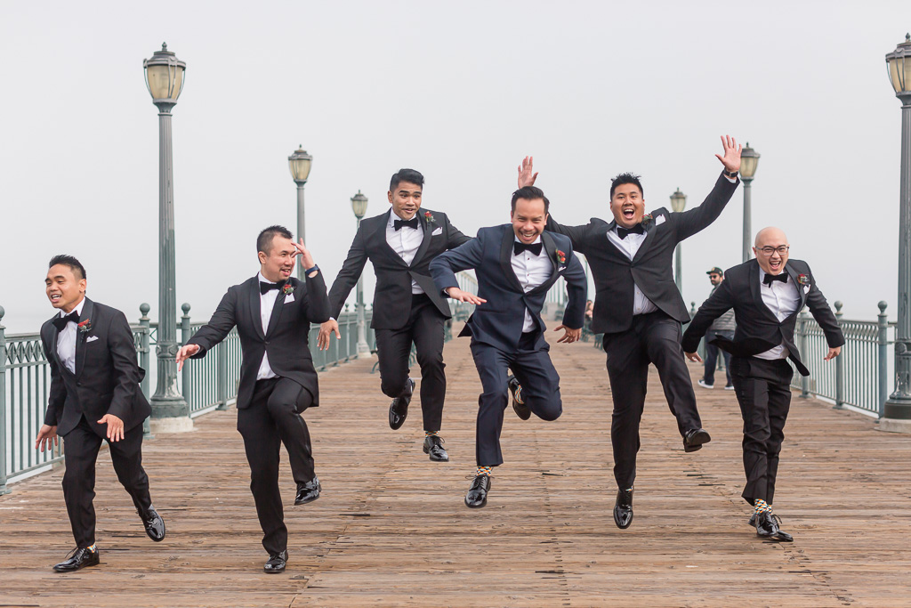 groom and her groomsmen being silly