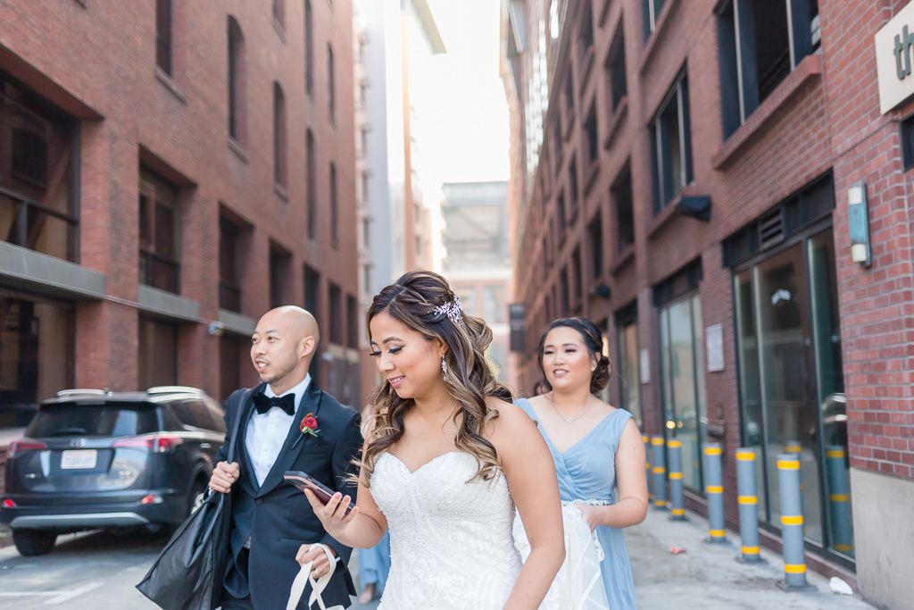 bride exiting Hotel Via for her first look