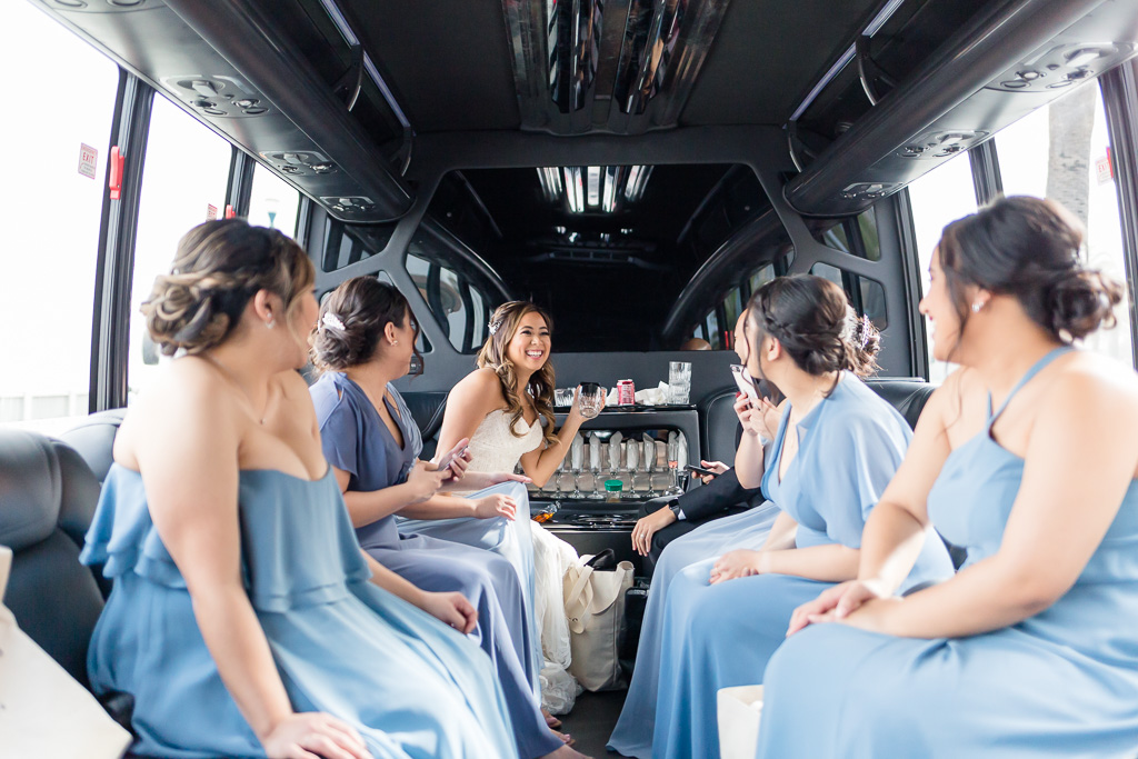 bride and bridesmaids in their limo heading to the pier