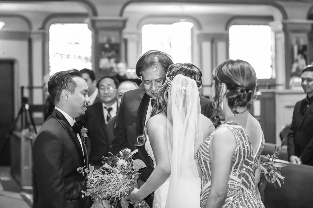 bride kissing father before he gives her away to the groom