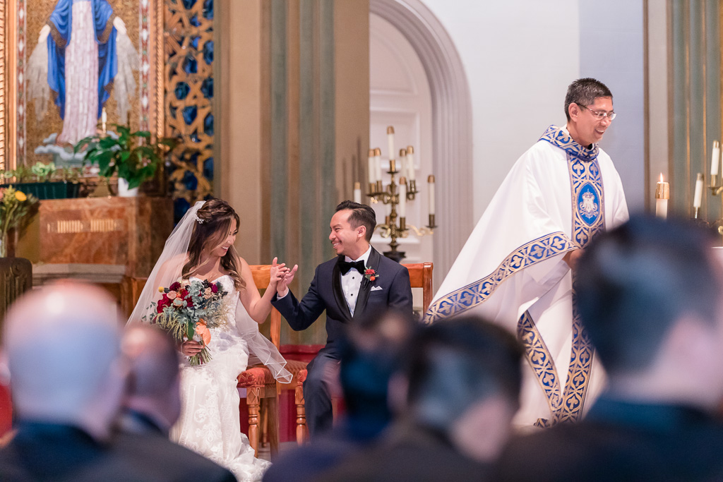 a sweet and happy moment between bride and groom during their church ceremony