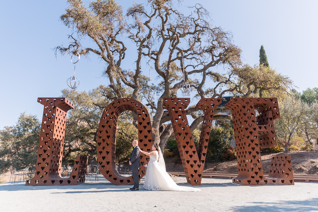 Willow Heights Mansion wedding first look by the love sign