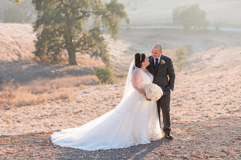 Willow Heights Mansion wedding photo out in the open field with beautiful sunlight