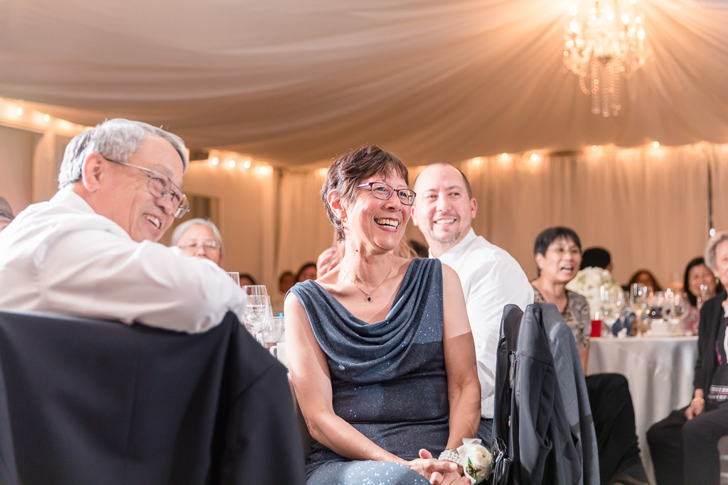 bride's parents laughing during reception speeches