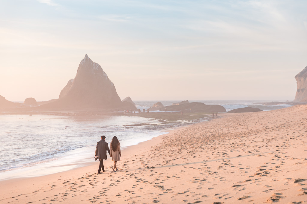 couple walking along the private and secluded Martin's Beach in Half Moon Bay