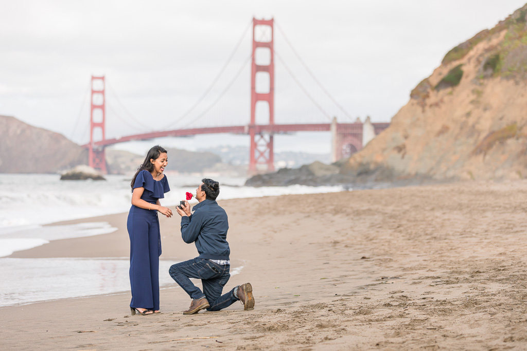 San Francisco surprise proposal in front of the Golden Gate Bridge at Baker Beach