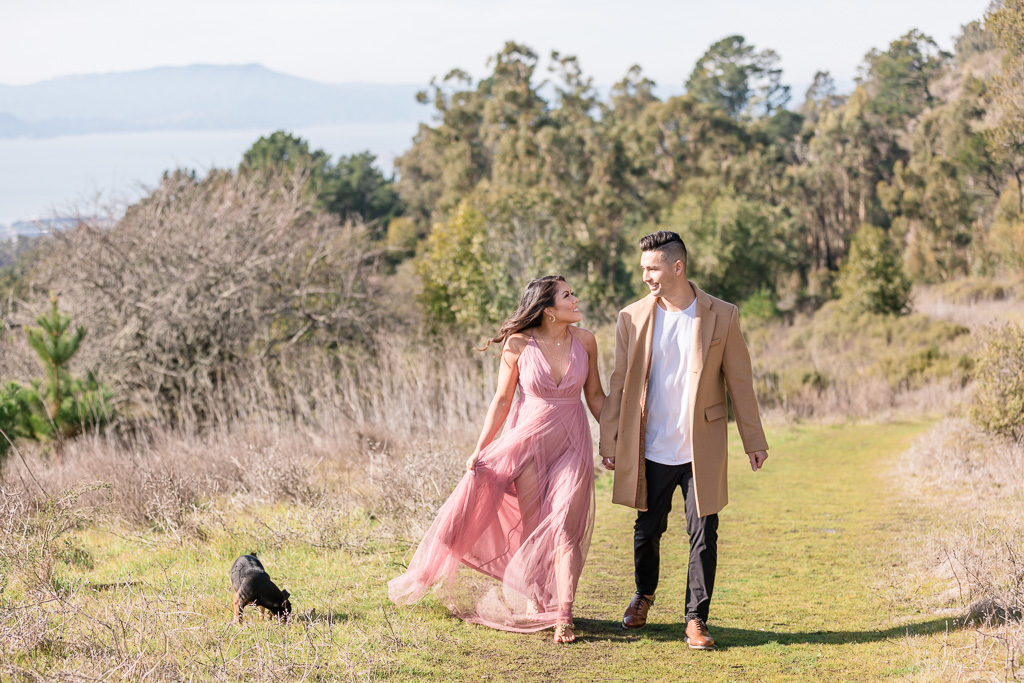 couple walking on the open trail in Berkeley for their save-the-date photo