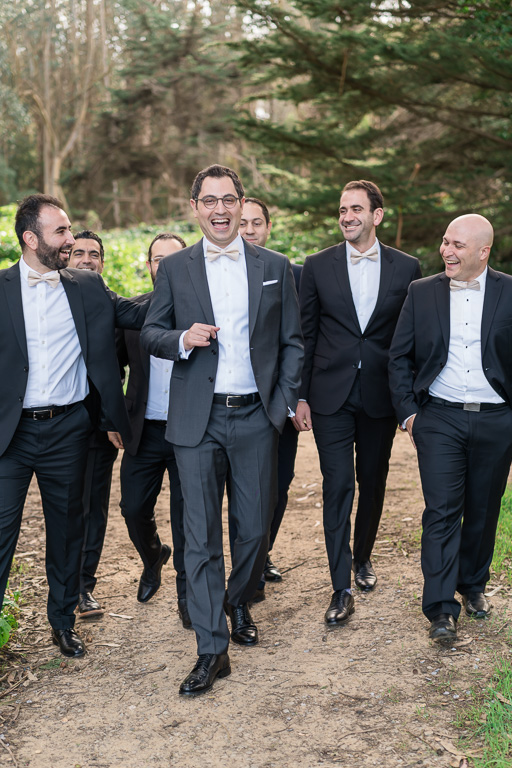 groom and his groomsmen walking to the chapel