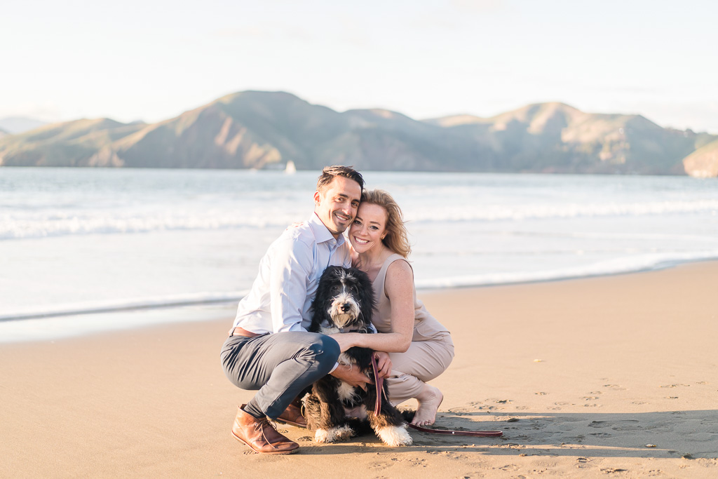 save-the-date picture at Baker Beach with a cute puppy