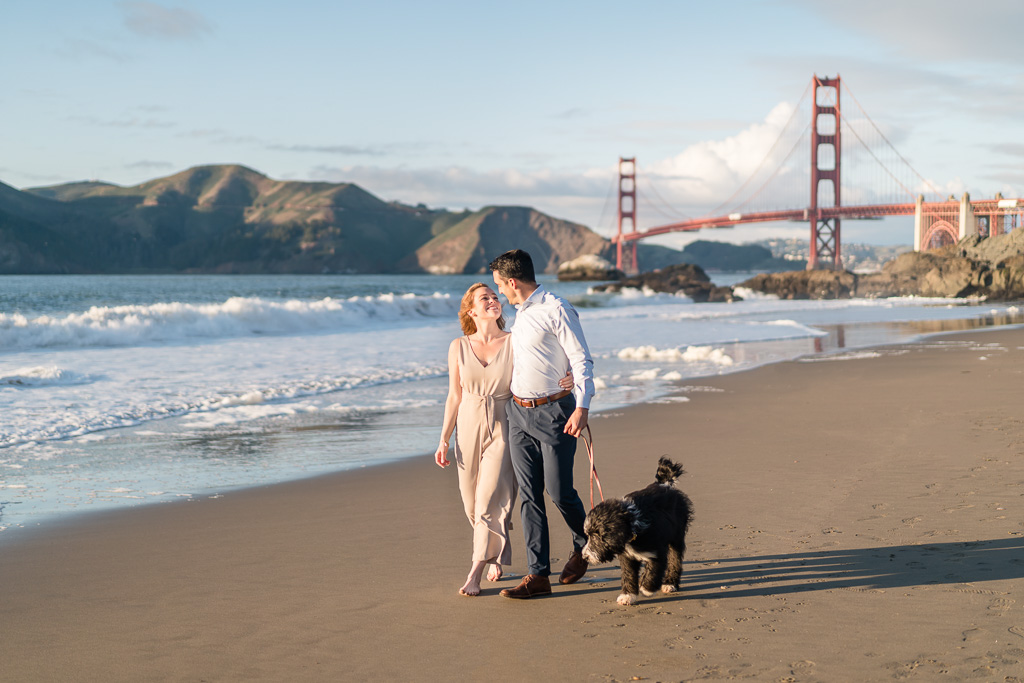 Golden Gate Bridge engagement photo on the beach with dog