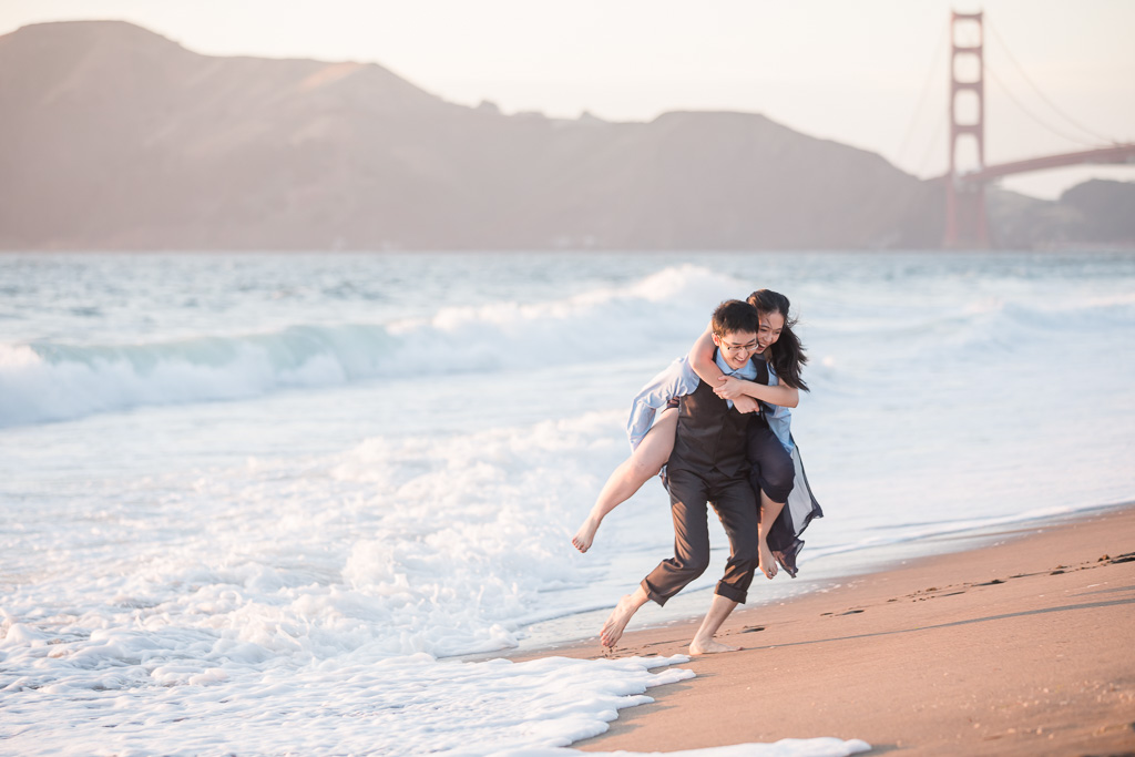 playful engagement session on the sand beach