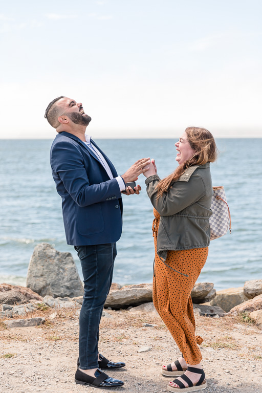 sweet laughing moment after their proposal by the Bay