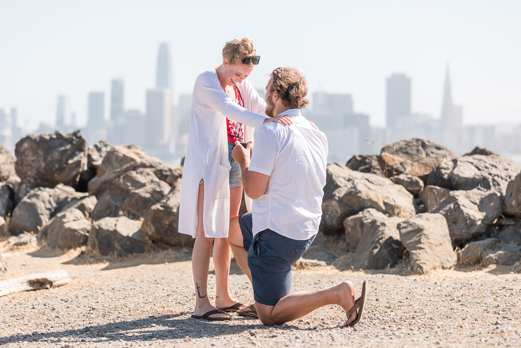 Treasure Island surprise proposal in front of San Francisco city skyline