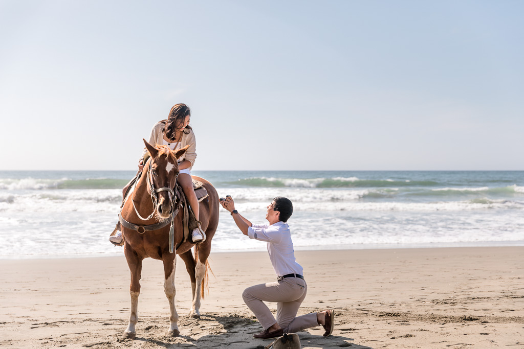 beach horseback ride surprise proposal with the girl on a horse