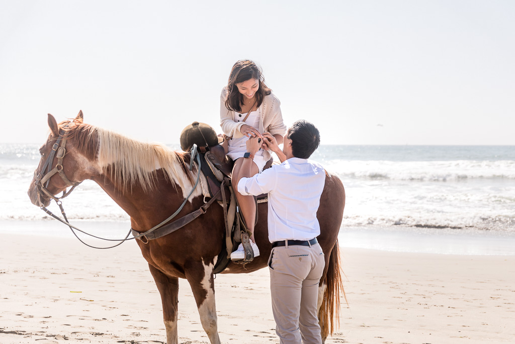 putting on the ring after horseback proposal