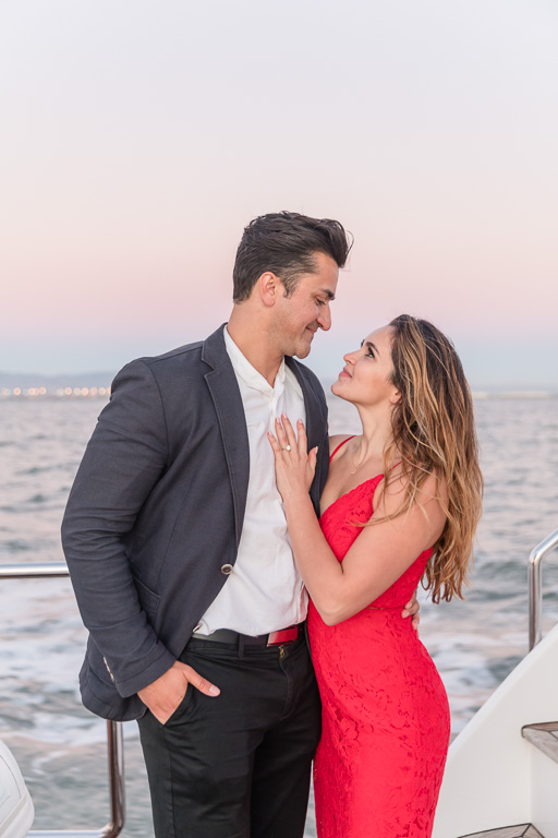 sunset engagement photo on a yacht