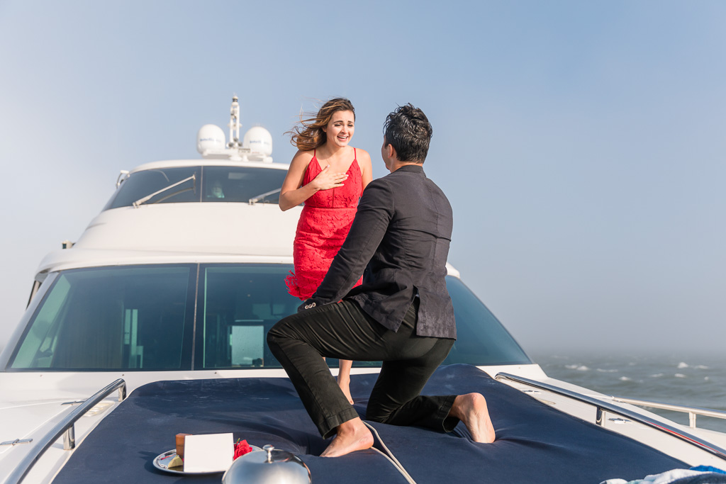 Surprise proposal at the bow of the Diamond Seas Yacht
