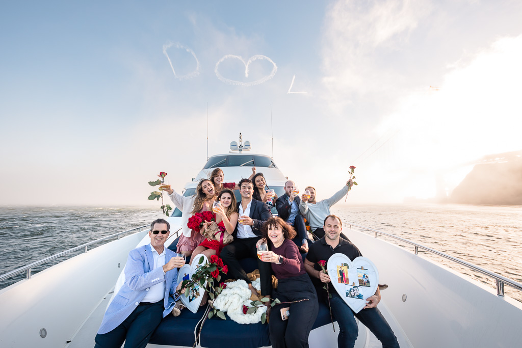 group photo at the front of a yacht