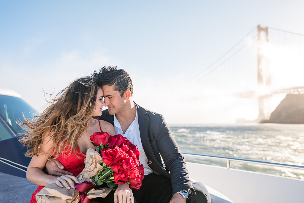 engagement photo on a boat in the San Francisco Bay with Golden Gate Bridge background
