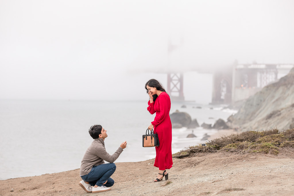 girl covering her mouth shocked reaction to surprise proposal