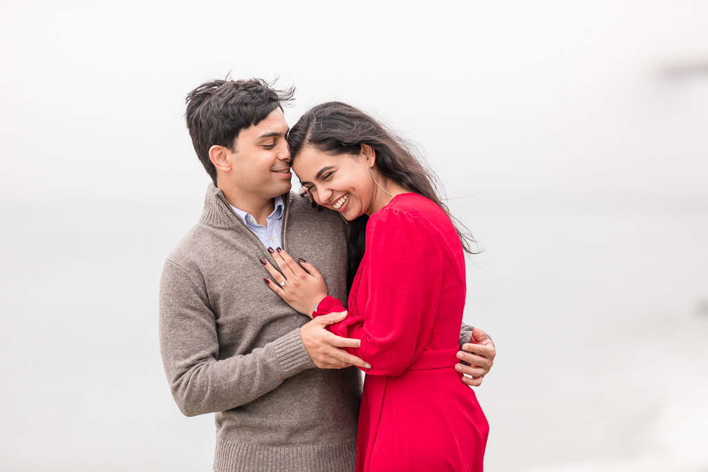 candid engagement photo in red dress