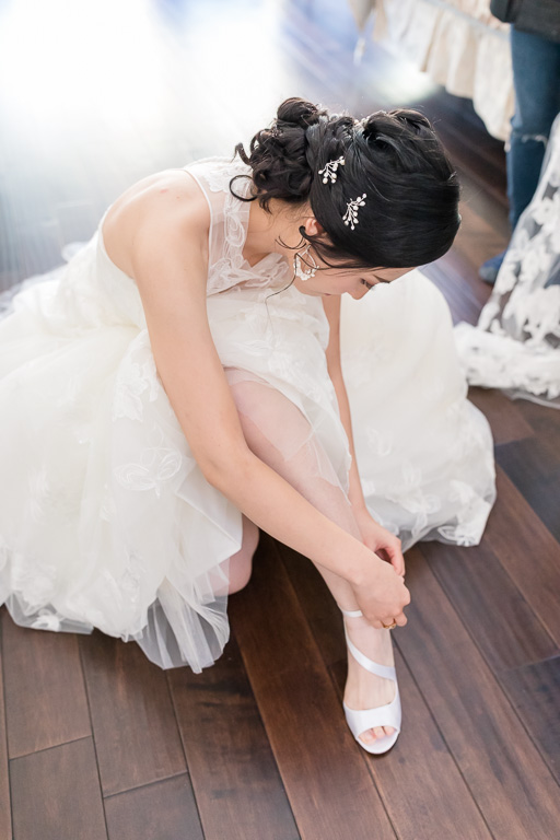 bride putting on her own shoes